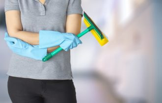 Female cleaning staff in bathroom blurry background Metaphor for cleaning Get rid of germs In bathroom, home office.For reliability And satisfaction of service and customers.